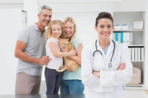 Family with pet and vet image